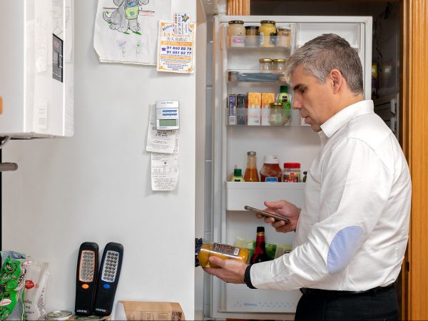 Christian Saintz using Seeing AI app on mobile phone to scan items n refrigerator