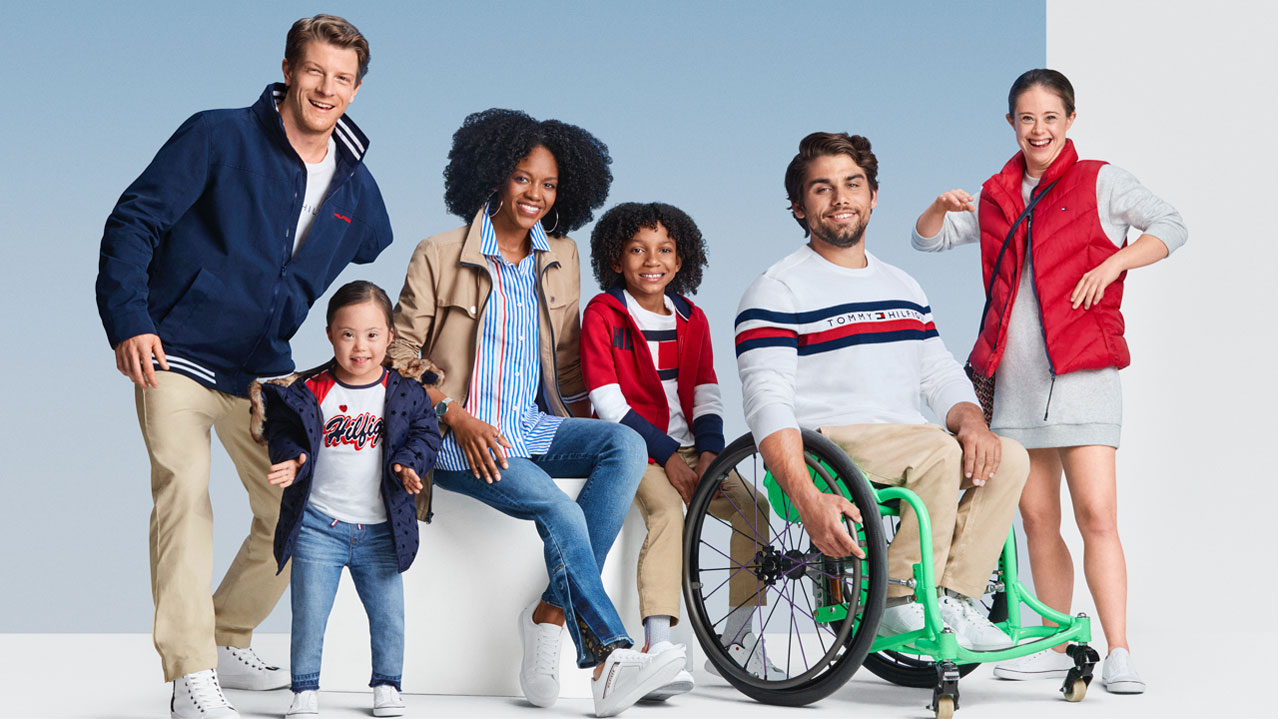 6 individuals modelling Tommy Hilfiger adaptive clothing.