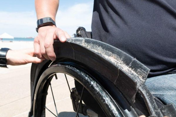 Close up of Gecko Traxx off road wheel on manual wheelchair rim accessory on manual wheelchair