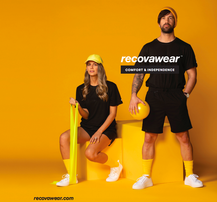 Man and women wearing black athletic clothing with recovawear logo