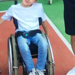 Young boy wheelchair user smiling