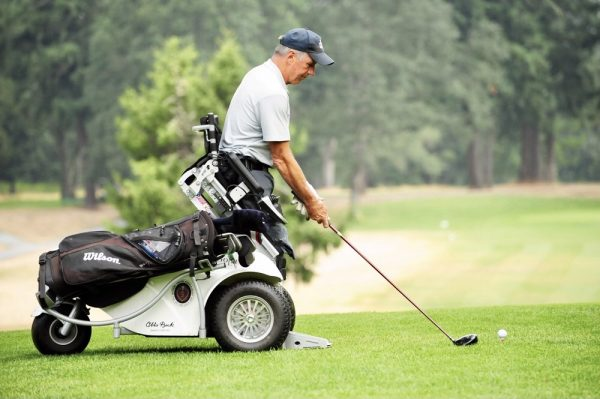 Golfer using ParaGolfer Sit to Stand Wheelchair