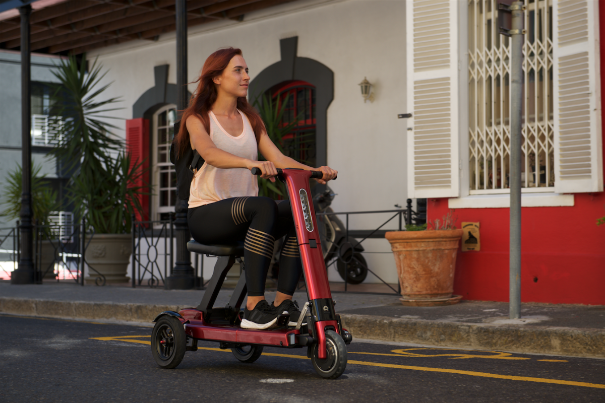 Young Person riding Relync Scooter