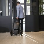 Person wheeling Relync Scooter like a suitcase