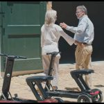 Older Couple travelling with 2 Relync Scooters