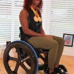 Athlete with gold medals in Carbon Black Chair