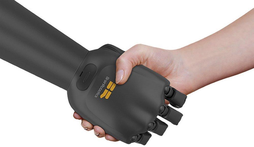 Brain Robotics black prosthetic hand shaking hands with human hand