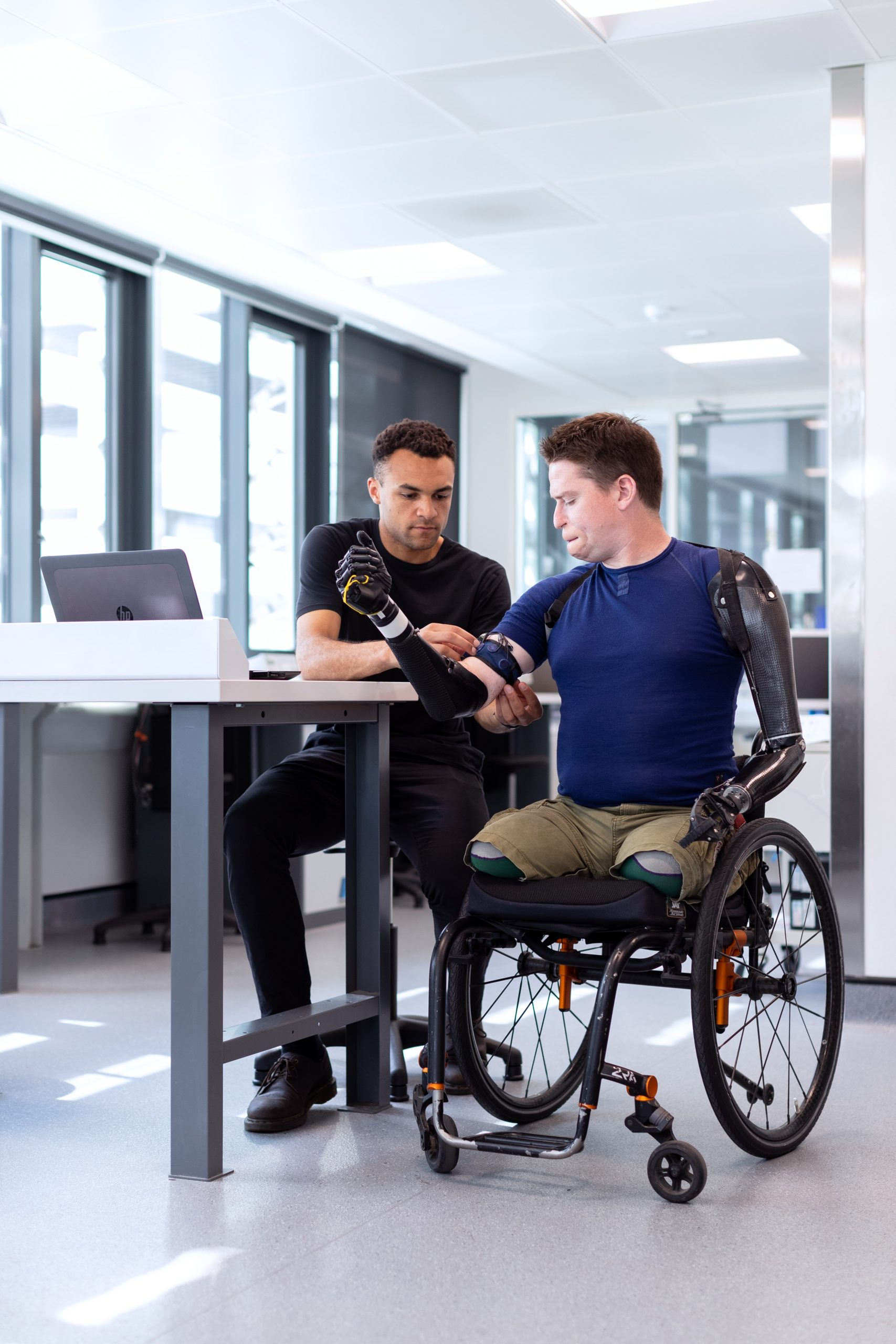 Therapist working with prosthetic and client