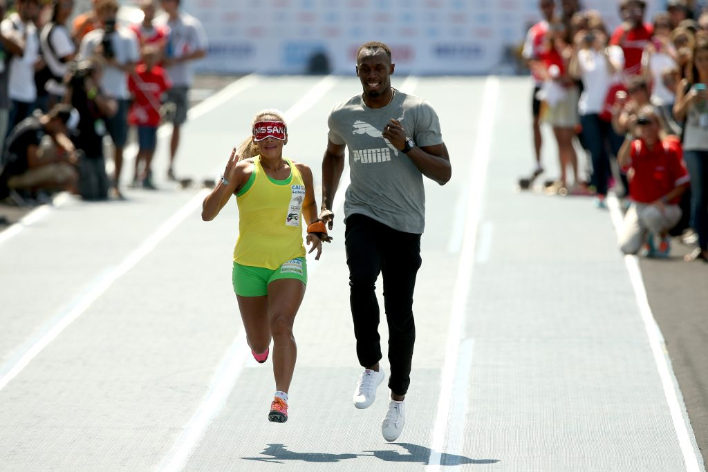 Usain Bolt as Guide Runner for visually impaired athlete