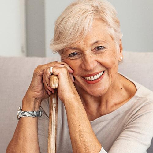 Smiling Senior with walking stick