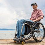 Man in wheelchair wearing billy dress shoes