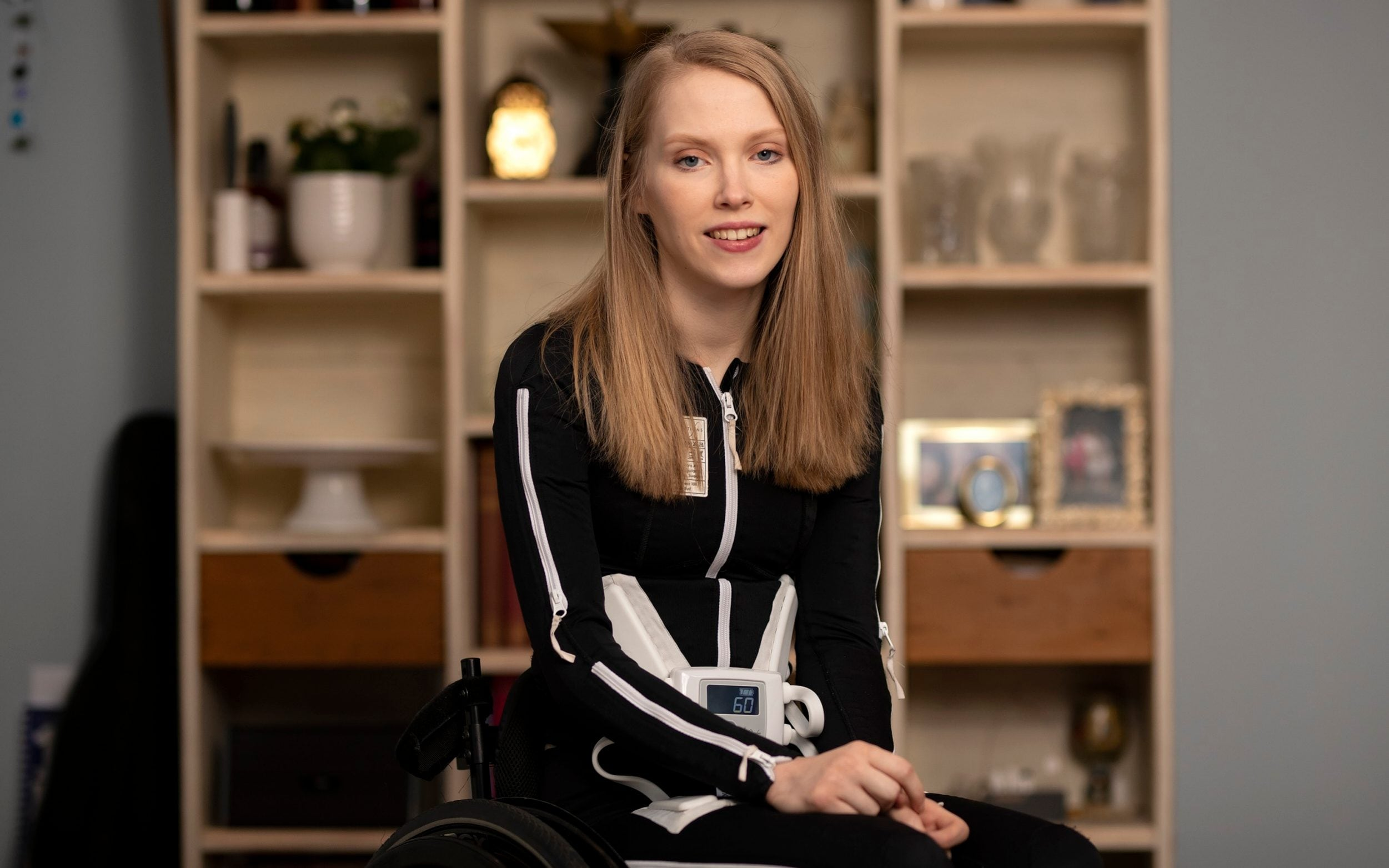 Young person in wheelchair wearing Mollii Suit