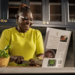Person wearing envision glasses to read menu cooking dinner