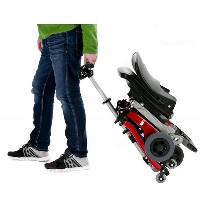 Person pulling folded Luggie Scooter like Suitcase