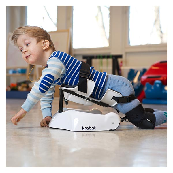 Young child in prone position using Krabat pilot to aid crawling