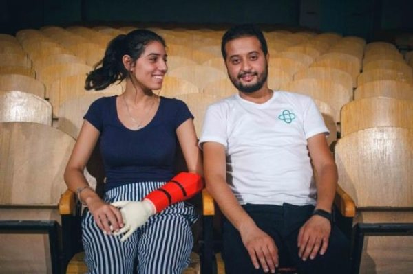 Red bionic arm worn by young woman