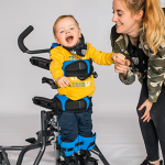 Toddler in Lecky Squiggles with carer laughing