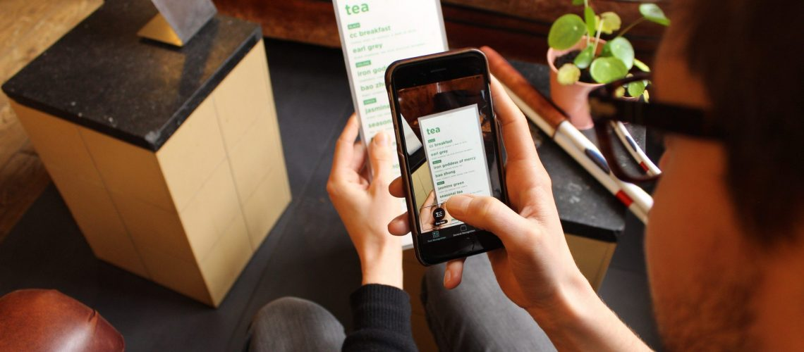 Envision App being used to read a menu card
