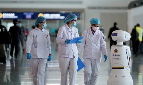 3 Medical workers with robot in Wuhan Hospital