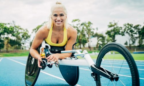 Madison De Razario, paralympic wheelchair racer with the barbie doll made of her in a racing chair